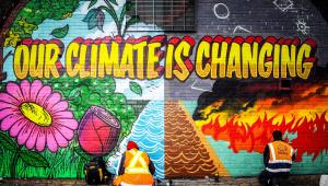 Grafiti reivindicando el cambio climático en Glasgow, celebrando la próxima COP26