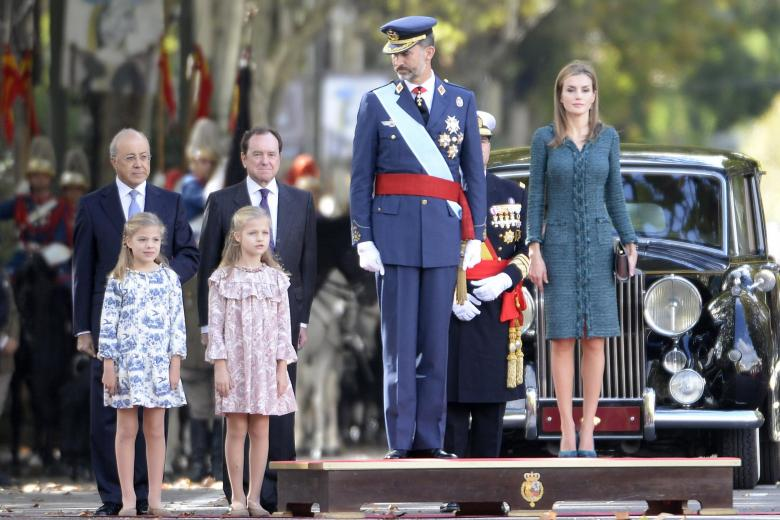 Kings of Spain, Felipe VI and Letizia Ortiz and their daughters princesses Leonor and Sofia of Borbon attending a military parade, during the known as Dia de la Hispanidad, Spain's National Day,  in Madrid, Spain, Sunday, Oct. 12, 2014.