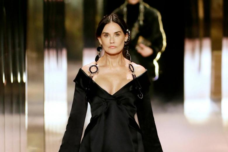 Actress Demi Moore wears a creation for Fendi's 2021 Haute Couture fashion collection presented Wednesday, Jan.27, 2021 in Paris.