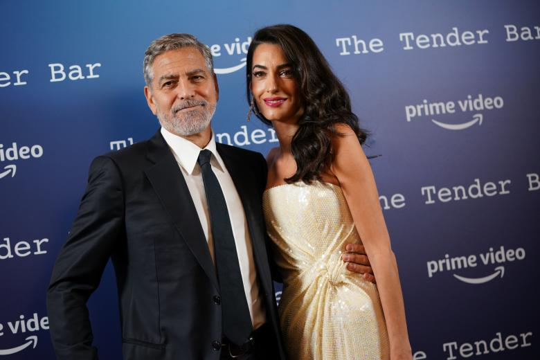 George Clooney with Amal Alamuddin during a photo call for the Tender Bar, during the BFI London Film Festival. Picture date: Sunday October 10, 2021. *** Local Caption *** .