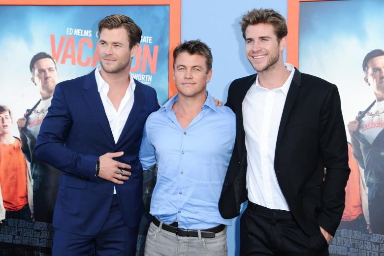 """Actors Chris Hemsworth, Luke Hemsworth and Liam Hemsworth arrive at the LA premiere of """"Vacation"""" held at the Regency Village Theatre on Monday, July 27, 2015, in Los Angeles."""