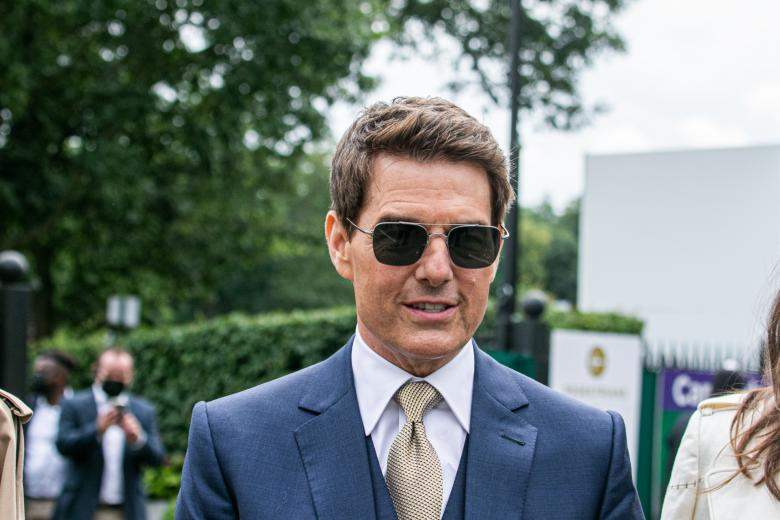 Actor Tom Cruise with actress Hayley Atwell during the Wimbledon Championships in London, Saturday, July 10, 2021.