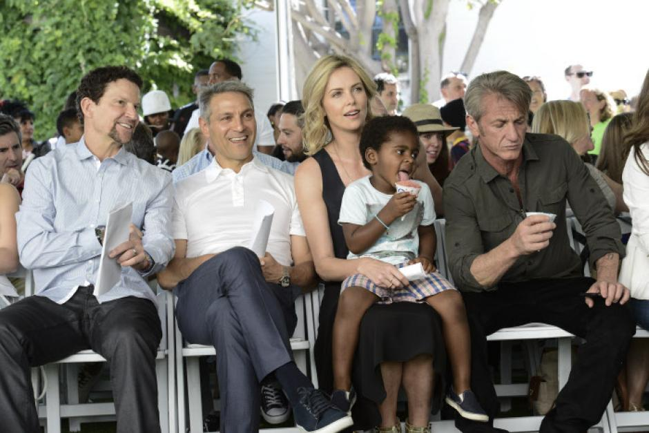 Hasbro President and CEO Brian Goldner,  WME Co-CEO Ari Emanuel, Jackson Theron, actress Charlize Theron, and actor Sean Penn attend the generationOn block in Los Angeles on Saturday, April 18, 2015